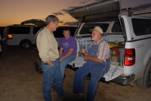 Larry Haverfield (right) talks with participants preparing for a night spotlight survey of Black-footed Ferrets on the ranch in 2009
