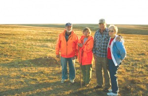 Larry and Bette Haverfield (left) stand with Gordon and Martha Barnhardt at the Black-footed Ferret reintroduction site in 2008. Note the ferret